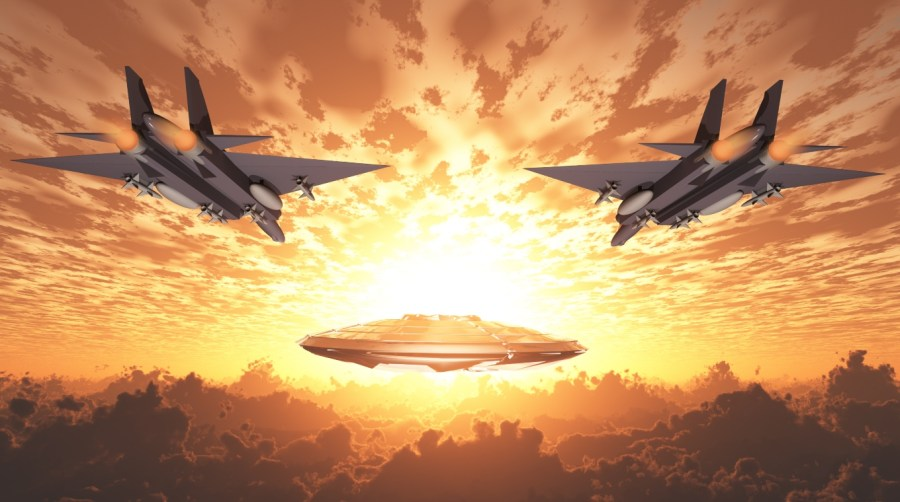 Two fighter jets follow a UFO