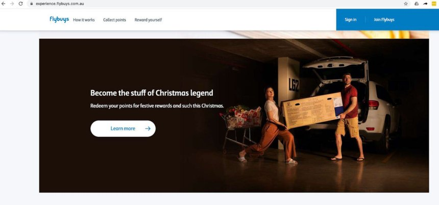 Flybuys website page with a photo of a couple doing their christmas shopping