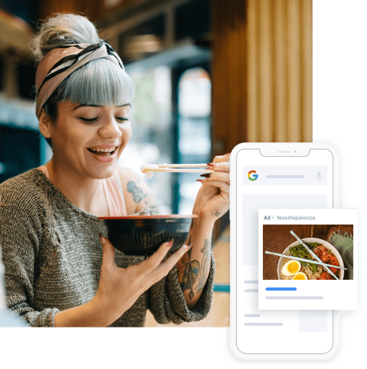 Girl eating food with phone showing website