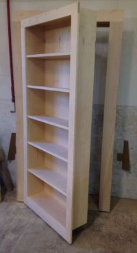 Handmade Secret Bookcase Door by Customcraft Homes