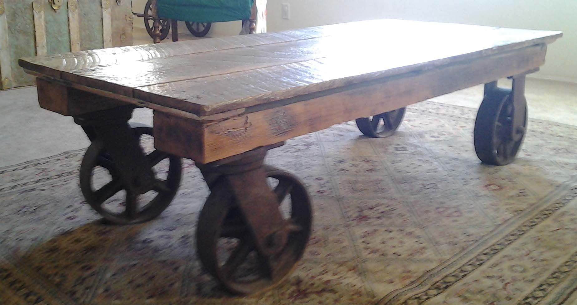Hand Made Coffee Table With Iron Industrial Wheels by The