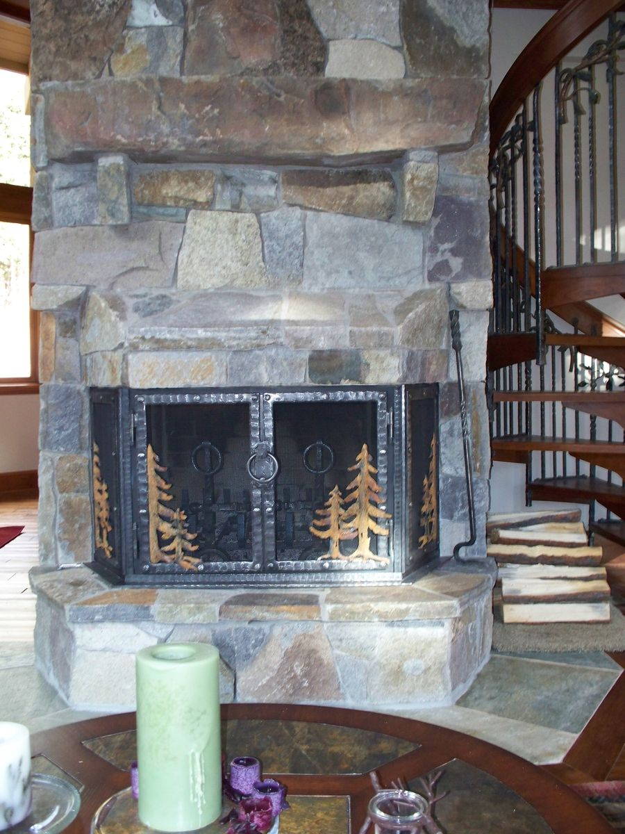 Hand Crafted Stone Fireplace Remodel With Hand Forged Iron Doors by Cabinets  Design Iron Llc