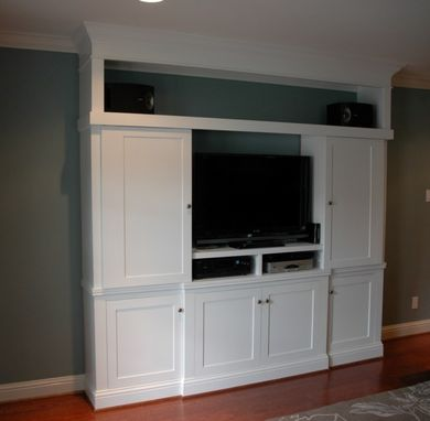 Hand Made Custom Entertainment Center With Sliding Doors by Custom Cabinets  Trim Carpentry