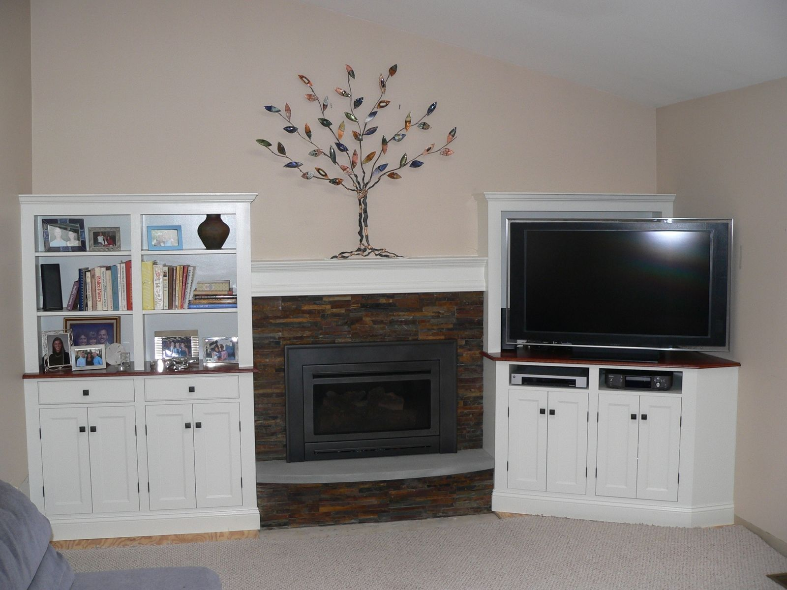 Custom Made Cabinets Around Fireplace by Meisterbuilders
