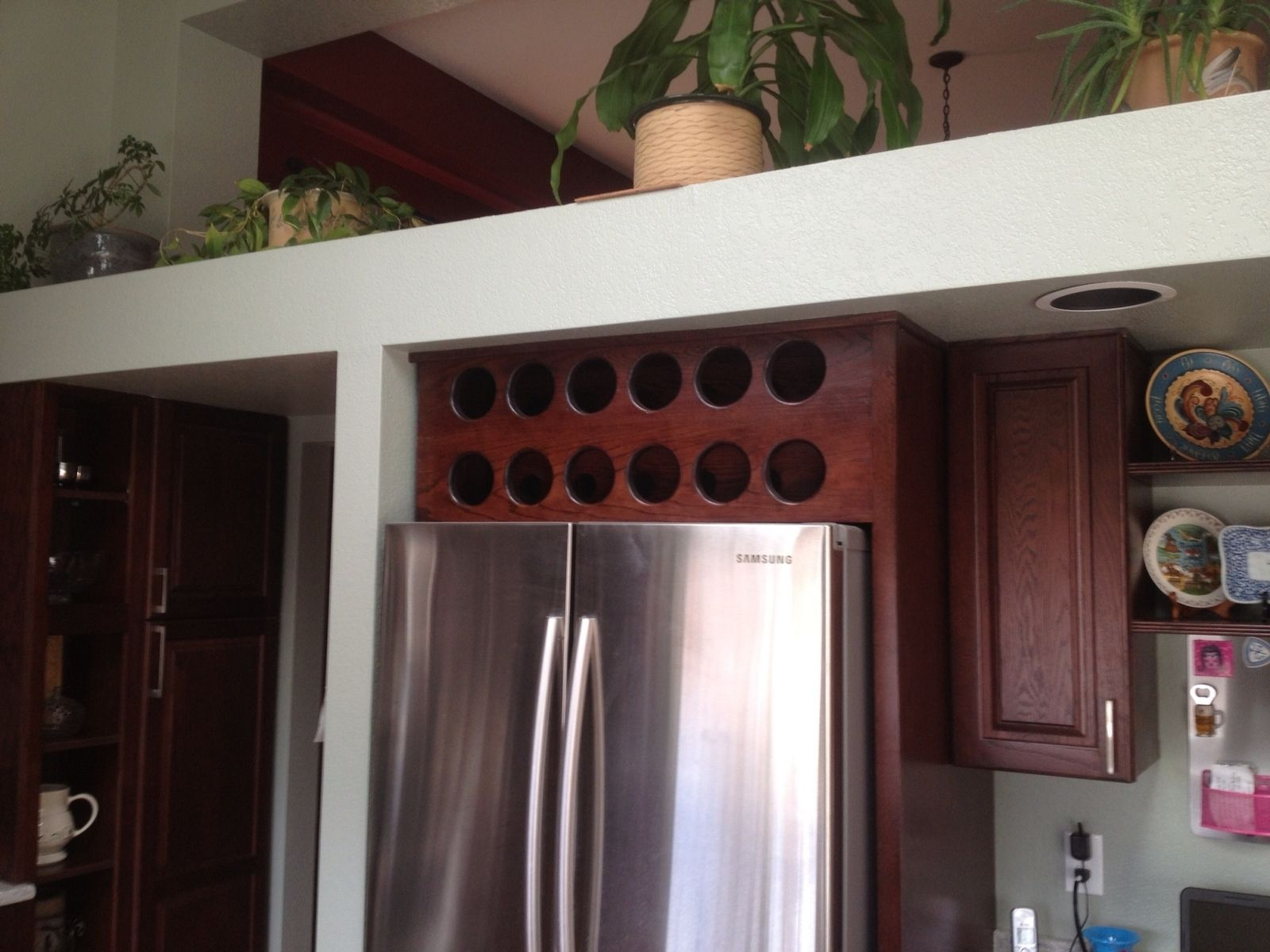 Handmade Open Wine Cabinet Above Refrigerator by Beack