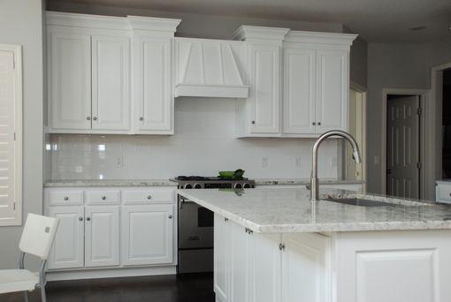 Custom White Transitional Kitchen by Belak Woodworking LLC