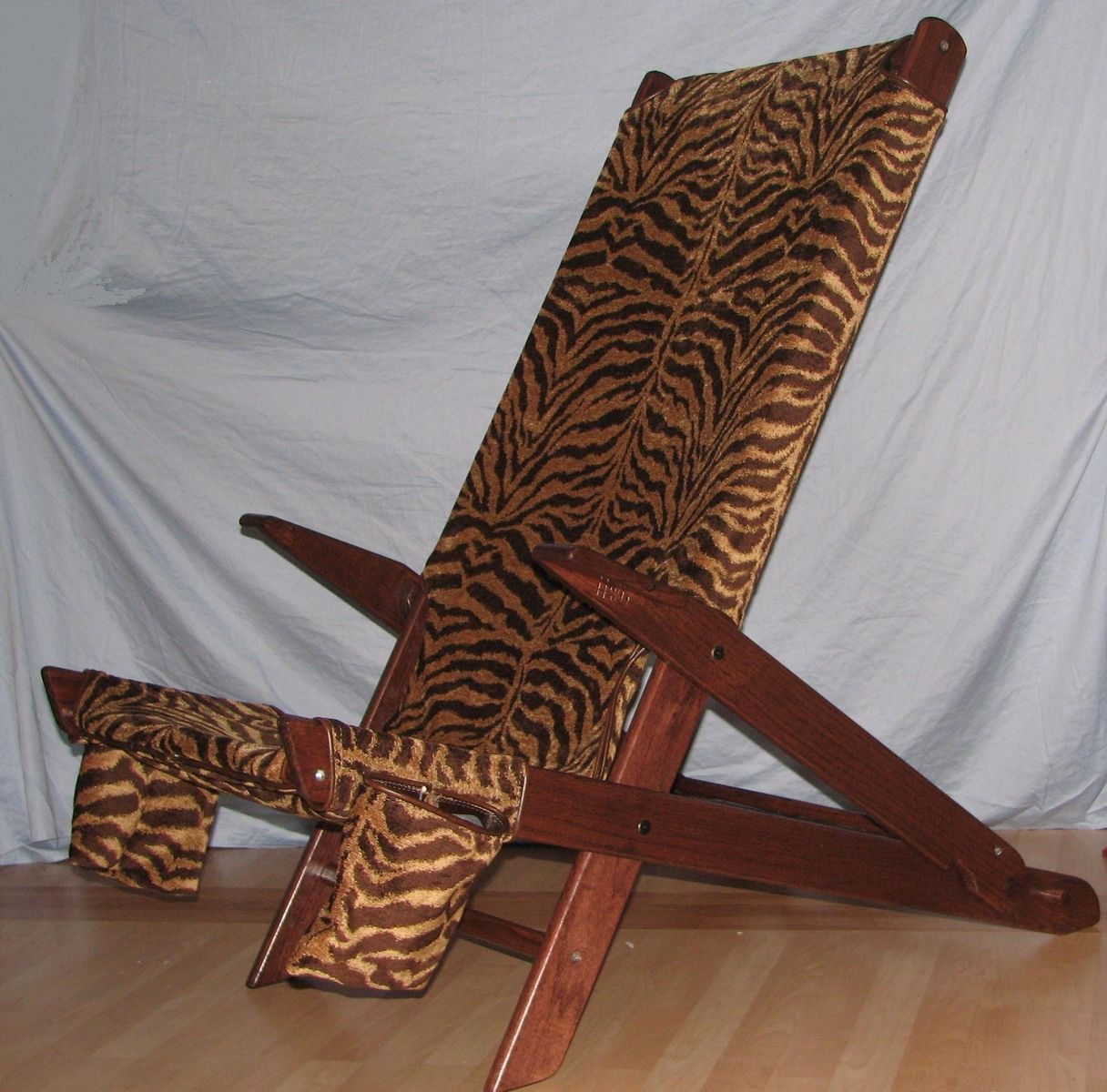 tiger print chair revolving pose hand made by heytens wood design inc