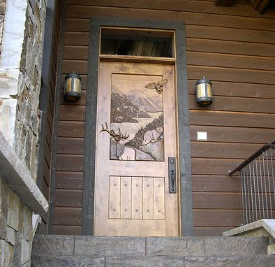 Custom HandCarved Entry Door by Christies Wood and Glass