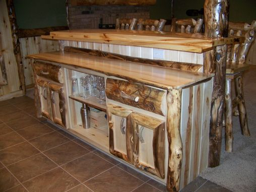 Hand Crafted Custom Refinished Basement With Log Bar Bar Stools And Wood Work by Irelands Wood