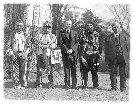 President Calvin Coolidge with four Osage Tribal members after Coolidge signed the bill granting American Indians full citizenship, 1924.