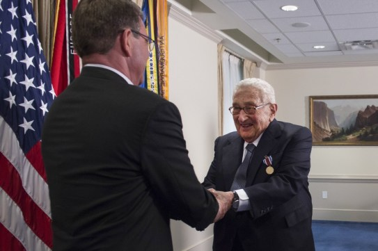 Secretary of Defense Ash Carter shakes Dr. Henry A. Kissinger's hand during an award ceremony at the Pentagon honoring him for his years of distinguished public service May 9, 2016. Dr. Kissinger was presented with the Department of Defense Medal for Distinguished Public Service.(DoD photo by Senior Master Sgt. Adrian Cadiz)(Released)