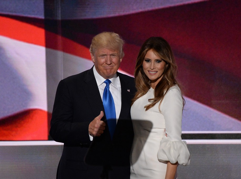 Presumptive Republican presidential candidate Donald Trump stands on stage with his wife Melania Trump following her address to delegates on the first day of the Republican National Convention on July 18, 2016 at Quicken Loans Arena in Cleveland, Ohio..The Republican Party opened its national convention, kicking off a four-day political jamboree that will anoint billionaire Donald Trump as its presidential nominee.  / AFP / Robyn BECK        (Photo credit should read ROBYN BECK/AFP/Getty Images)