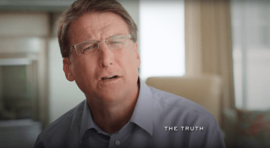 "Screenshot from the TV ad, which an includes a chyron reading, ""The Truth."""
