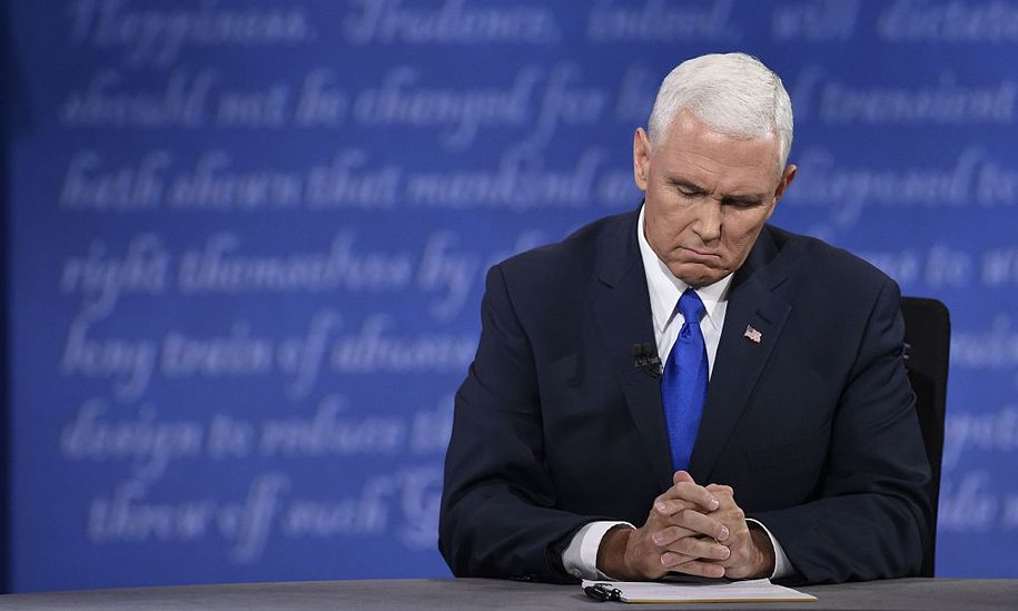 Republican candidate for Vice President Mike Pence pauses during the vice presidential debate at Longwood University in Farmville, Virginia on October 4, 2016. / AFP / SAUL LOEB        (Photo credit should read SAUL LOEB/AFP/Getty Images)