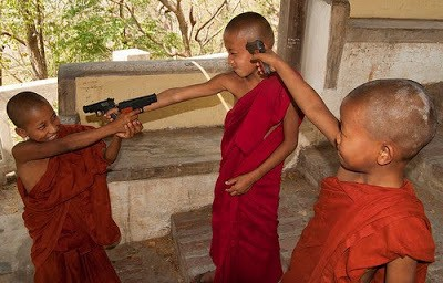 monastics_novices_playing_with_toy_guns_SE_Asia_Woutertje010_on_Flickr_1_.jpg