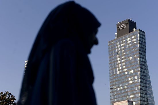 A woman walks past the Trump Towers building in Istanbul on July 30, 2015. US billionaire Donald Trump handily leads all fellow Republicans in the 2016 presidential race, Hillary Clinton and other Democrats trump him in head-to-head matchups, a poll said July 30. AFP PHOTO/ OZAN KOSE        (Photo credit should read OZAN KOSE/AFP/Getty Images)