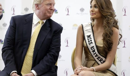 Donald Trump, left, and Miss Universe, Gabriela Isler, of Venezuela, talk during a news conference, Thursday, Oct. 2, 2014, in Doral, Fla. Three of the last six Miss Universe titles have gone to Venezuelan contestants. This year's Miss Universe competition .