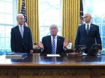 US President Donald Trump, with Vice President Mike Pence (R) and Health and Human Services Secretary Tom Price (L), speaks from the Oval Office of the White House in Washington, DC, on March 24, 2017..Trump on Friday asked US Speaker of the House Paul Ryan to withdraw the embattled Republican health care bill, moments before a vote, signaling a major political defeat for the US president. / AFP PHOTO / MANDEL NGAN (Photo credit should read MANDEL NGAN/AFP/Getty Images)