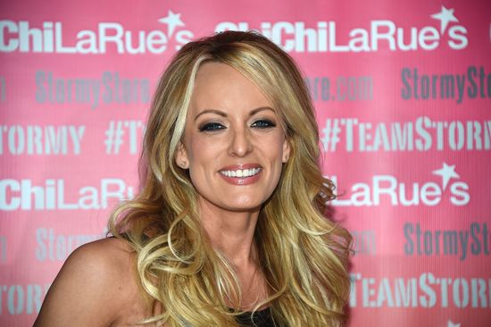 "Adult film star Stormy Daniels poses and signs autographs at Chi Chi Larue's adult entertainment store May 23, 2018 in West Hollywood, California. - Daniels, whose real name is Stephanie Clifford, earned international headlines for her legal battle with President Donald Trump over an alleged affair she claims the pair had a decade ago. West Hollywood Mayor John Duran proclaimed May 23, 2018 ``Stormy Daniels Day'', recognizing Clifford for ""her leadership in the #RESIST movement.'' (Photo by Robyn Beck / AFP)        (Photo credit should read ROBYN BECK/AFP/Getty Images)"