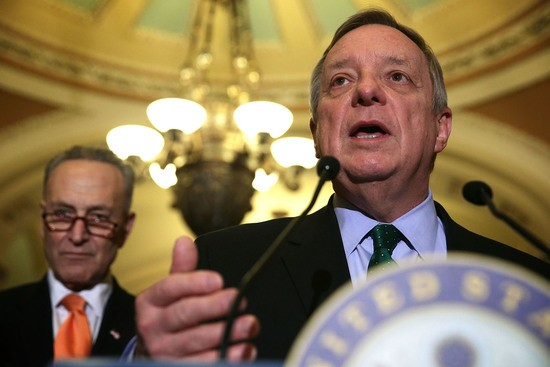 WASHINGTON, DC - JANUARY 20:  U.S. Senate Minority Whip Richard Durbin (D-IL) (R) speaks as Sen. Charles Schumer (D-NY) (L) listens after the Democratic weekly policy luncheon January 20, 2016 on Capitol Hill in Washington, DC. Senate Democrats held its weekly luncheon meeting to discuss Democratic agenda.  (Photo by Alex Wong/Getty Images)