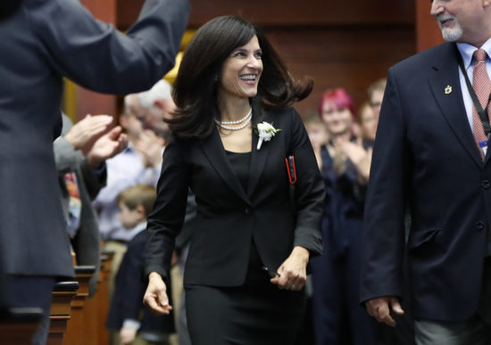 FILE -- In this Wednesday, Dec. 5, 2018, file photo Sara Gideon, D-Freeport, arrives in the House Chamber after being re-elected Speaker of the House, at the State House, in Augusta, Maine. Democrats angry over Republican Sen. Susan Collins' vote for Supreme Court nominee Brett Kavanaugh are champing at the bit to unseat her and there's a crowd-sourced nest egg awaiting her challenger. But so far, no big-name Democrats have formally announced they'll challenge Collins, in 2020. Gideon is among Democrats who've stated interest in running for the seat. (AP Photo/Robert F. Bukaty, File)