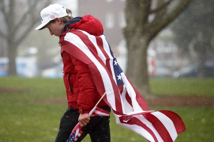 LANSING, MI - APRIL 15: A person walks towards the Capitol building along with others to express their unhappiness with Governor Gretchen Whitmer's Stay Safe, Stay Home executive order on April 15, 2020 in Lansing, Michigan. Governor Whitmer issued the order which was expanded until April 30 to continue to help slow the spread of coronavirus (COVID-19). As of April 14 the state of Michigan reported over 27,000 confirmed cases of coronavirus (COVID-19) and over 1,700 related deaths.  (Photo by Elaine Cromie/Getty Images)