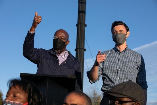 MARITA, GA - November 15: Democratic U.S. Senate candidates John Osoff (R) and Raphael Warnock (L) hold a rally in Mareta, Georgia, on November 15, 2020.  Osof and Warnock face the American Sense.  (Photo by Jessica McGowan / Getty Images)