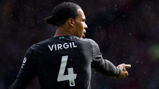 Why does Van Dijk have 'Virgil' on his Liverpool shirt?