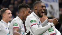 Boye sees red as Ekambi's double powers Lyon past Metz