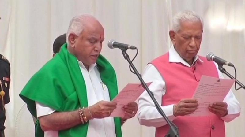 Karnataka Government formation: B S Yeddyurappa takes oath as the Chief Minister of Karnataka. (Photo: ANI | Twitter)