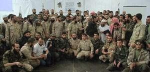 """Gruppenfoto von den Kämpfern der """"Armee des Islam""""."""