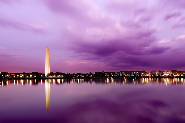 Photo of a purple sky over the Washington Monument and nearby buildings in Washington, DC