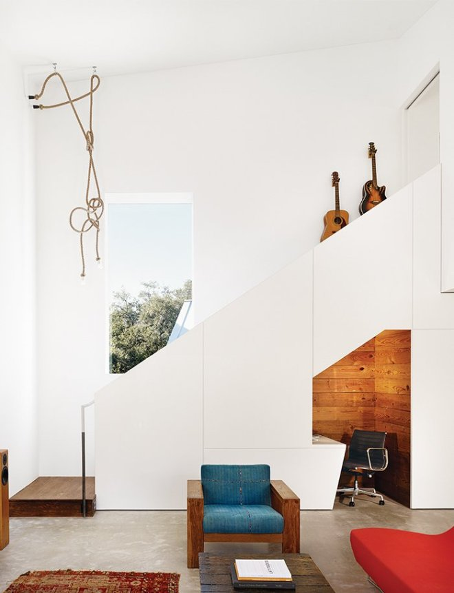 10 Smart and Surprising Under-Stair Design Solutions - Photo 3 of 10 - In this home in Austin, Texas, architect Kevin Alter of Alterstudio renovated a 1920s bungalow to include a rustic but modern office nook under the new stairs leading to a second floor. By outfitting the walls of the office in knotty pine, the space contrasts with the surrounding white walls and becomes a design feature rather than a forgotten space.