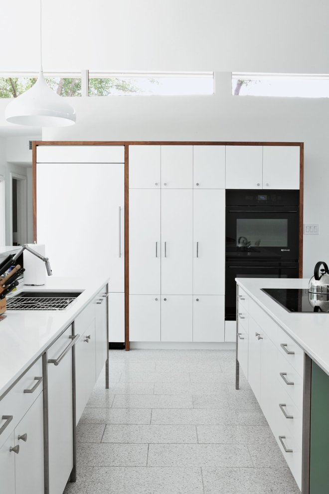 These 30 White Kitchens Are Anything But Ordinary - Photo 17 of 30 - The cooktop, refrigerator, and wall ovens are by Jenn-Air; the sink and faucet are by Kohler; and the countertops are from Caesarstone.