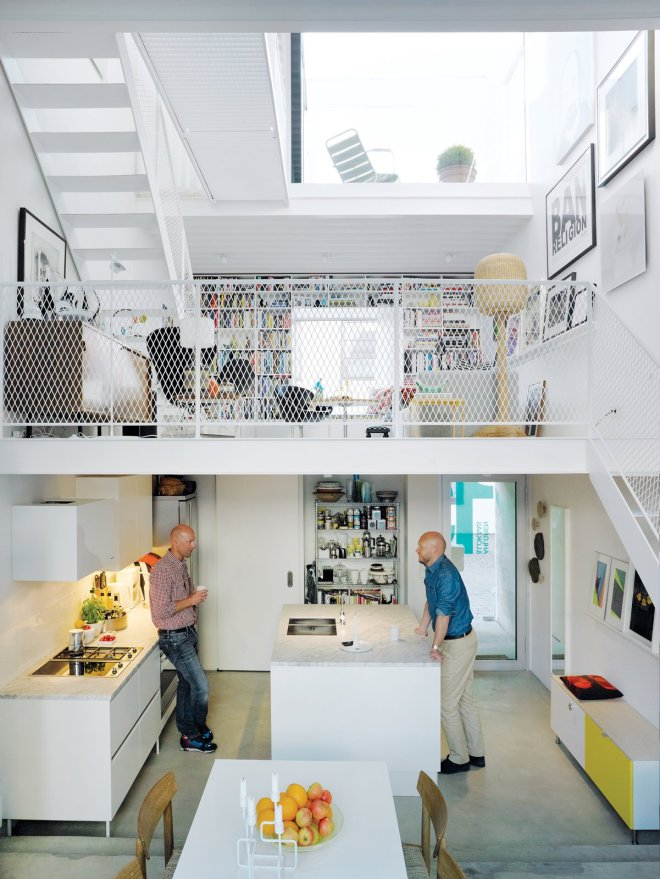 These 30 White Kitchens Are Anything But Ordinary - Photo 25 of 30 - Three thin slabs have been staggered vertically through the space to create three distinct floors and allow light to flood in from the front, back, and roof. The white Saari kitchen makes the most of a compact space.