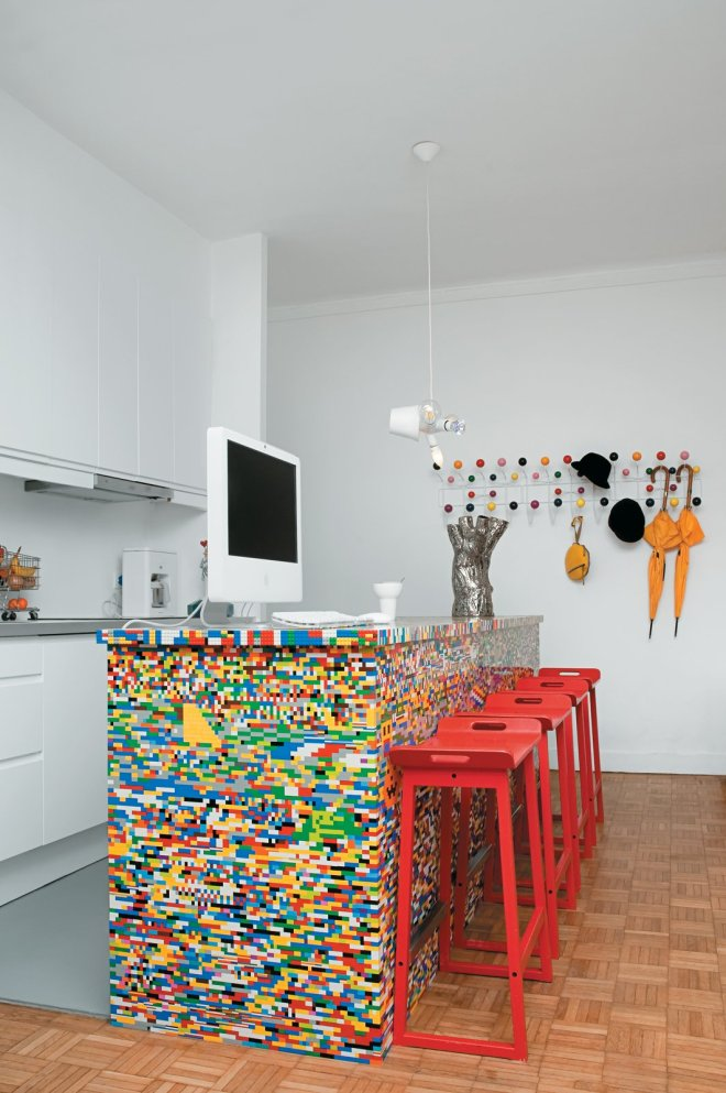 Kitchen and White Cabinet The idea for Simon Pillard and Philippe Rossetti's Lego kitchen island in Paris sprouted when Pillard put 500 blocks and a day's worth of work into building a Lego-legged chair. They covered their kitchen island—a simple wooden block—with 20,000 Lego pieces.