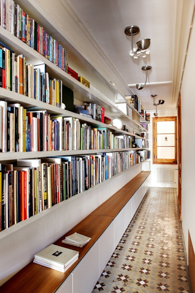 6 Hallway Hacks to Turn Them Into Usable Space - Photo 7 of 12 - You may think that a library has to be its own room, but books can be stored and read just about anywhere. Lining a hallway with books turns it into a library that you'll walk through, and be inspired by, every day. Cabinets below provide extra storage and even a place to sit and read.