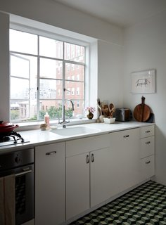 gray tile kitchen floor recessed lighting for best modern ceramic floors design photos and ideas dwell this compact brooklyn features a white corian counter integrated sink ikea cabinets with