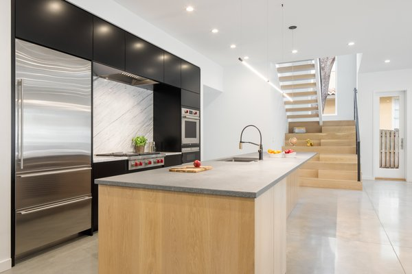 how to design kitchen top rated faucets best modern photos and ideas dwell the home s features white oak cabinetry an eye catching solid marble backsplash