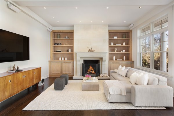 modern living room with dark wood floors 1950s early american furniture best 38 hardwood burning dwell the tv nook sits just off built in shelving flanks a