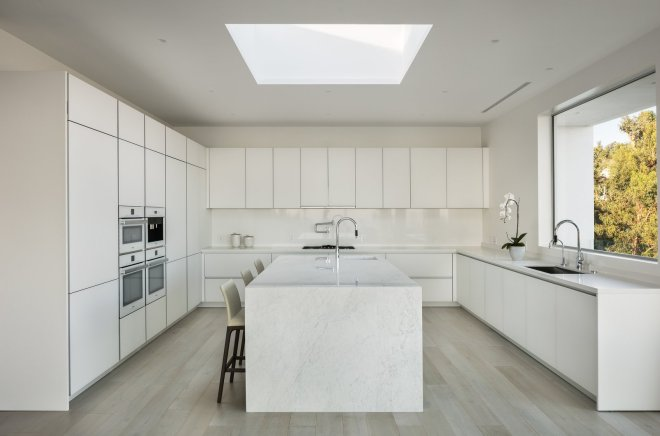 These 30 White Kitchens Are Anything But Ordinary - Photo 18 of 30 - While minimally modern in the aesthetic, this home provides a comfortable space for the occupants to immerse themselves within nature.
