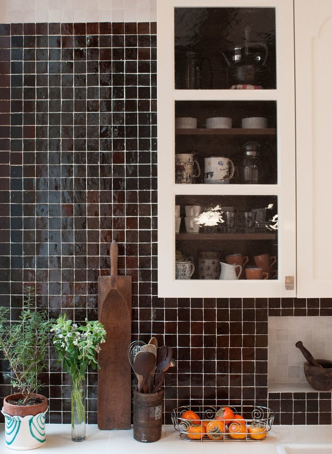 25 Backsplash Ideas For Your Kitchen Renovation - Photo 21 of 25 - Hand-made Moroccan tile backsplash by Mosaic House with contrasting niche; custom kitchen cabinets designed by MIRIAM BIOLEK Interior Design with Bendheim's mouth-blown glass inserts.