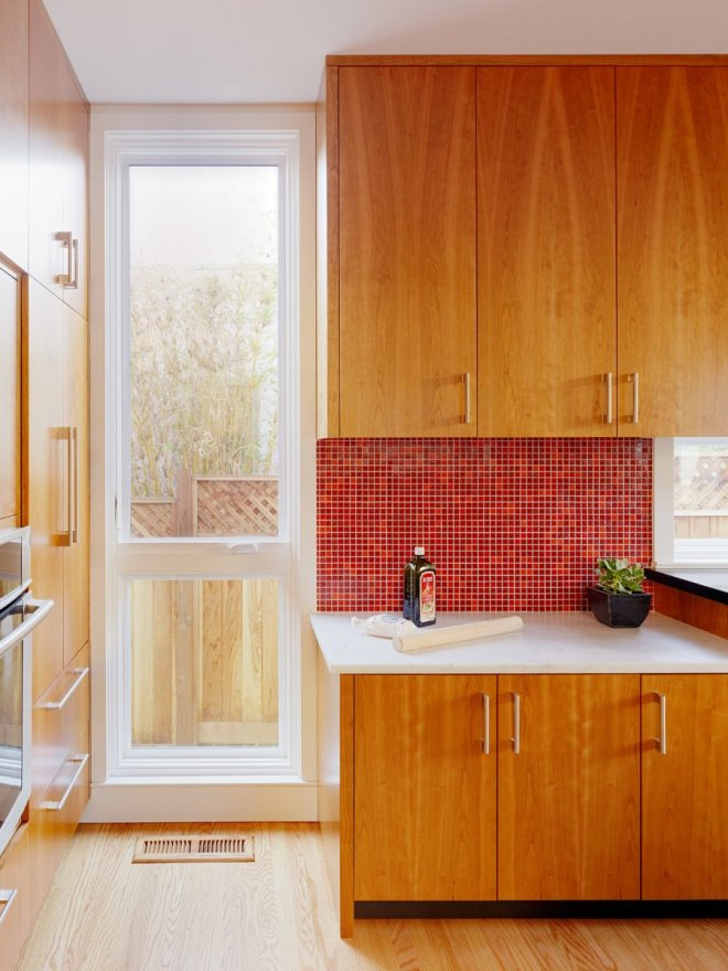 25 Backsplash Ideas For Your Kitchen Renovation - Photo 12 of 25 - In this California home, a red mosaic tiled backsplash balances the lower white marble counter.