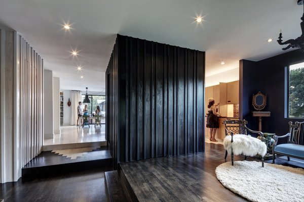 dark wooden floors living room how should i decorate my quiz best 60 modern hardwood design photos and black walls were used to create contrast the board batten