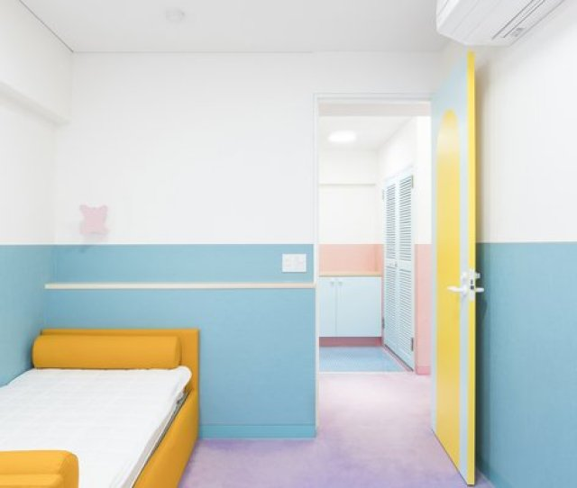Each Bedroom Has Colored Wainscotting But Is Otherwise Minimally Furnished Aside From A Boldly Colored
