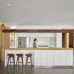 Kitchen Stone Table With Benches Best Modern Slab Backsplashes Design Photos And Ideas The Scheme Features Banks Of White Flat Front Cabinets For Serene Contrast