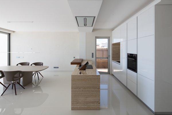 kitchen stone aid hood best modern slab backsplashes design photos and ideas the shiny finish on custom cabinets syncs with high gloss flooring