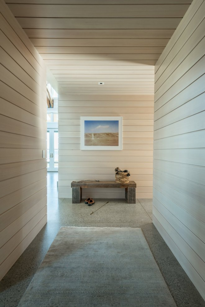 6 Hallway Hacks to Turn Them Into Usable Space - Photo 6 of 12 - A bench in a hallway can also provide a moment of respite, encouraging new perspectives and rhythms within a residence, even if it's just a pause to look out a window or into another room.