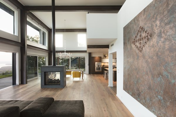 wooden floors in living rooms with dark brown sofas best 4 modern room medium hardwood design photos and the area of 2 barns features a doubled sided fireplace