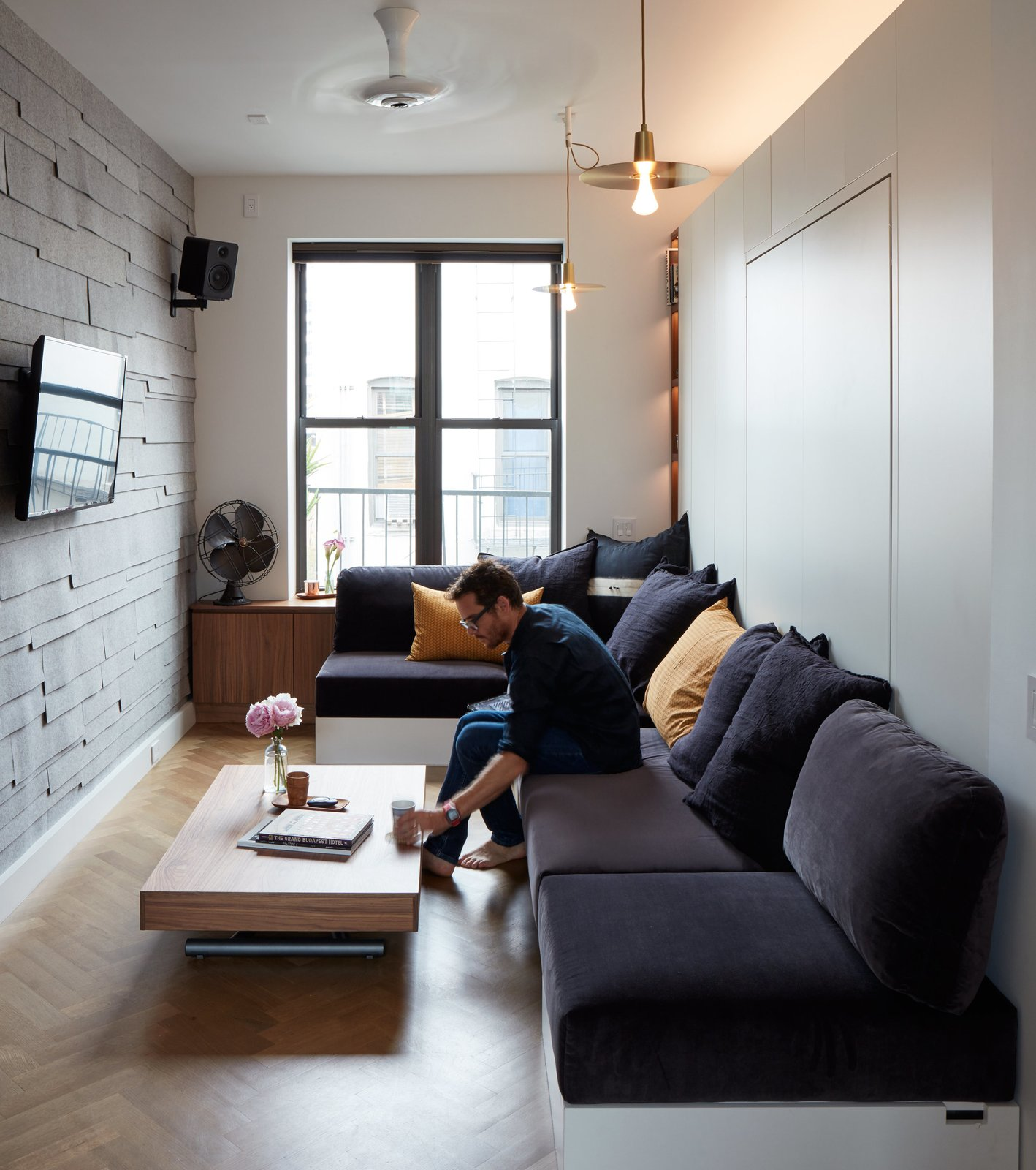living room small apartment dark wood floors in space a soho dwell at his 350 square foot champion graham hill practices what he preaches